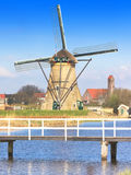 Beautiful dutch windmill house lands Royalty Free Stock Image