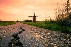 Beautiful Dutch windmills at sunset from Holland royalty free stock images
