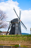 Beautiful Dutch windmill   Typical landscape in Ja Royalty Free Stock Photos