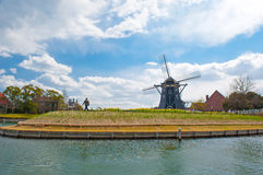Beautiful Dutch windmill   Typical landscape in Ja Stock Images