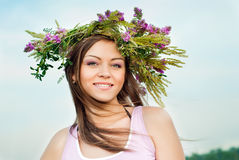 Beautiful e girl in a wreath of flowers Royalty Free Stock Photo