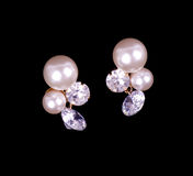 Beautiful ear-rings with pearls and diamonds Royalty Free Stock Images