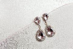 Beautiful wedding jewellery earings detail. Beautiful earings jewellery of the Bride before wedding - romantic detail Royalty Free Stock Images