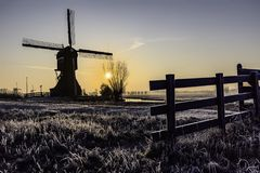 Warm and frozen windmill sunrise Stock Photos