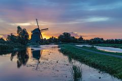 Sunrise on the Dutch windmill royalty free stock photos