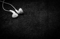 Beautiful earplugs on wood surface Royalty Free Stock Image
