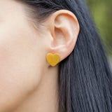 Beautiful earring. Woman wearing a beautiful heart shape earring Royalty Free Stock Photos