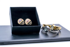 Beautiful earrings in a box and two watches Royalty Free Stock Image