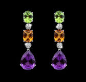 Beautiful Earrings with colorful gems Royalty Free Stock Photography