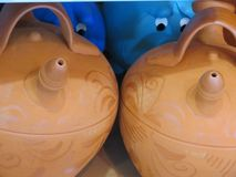 Beautiful earthenware pitchers of mud ready to cool water royalty free stock photos