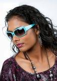 Beautiful east indian woman wearing sunglasses Stock Photo