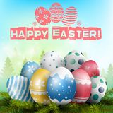 Beautiful Easter background with colorful eggs on the pine tree Royalty Free Stock Photography