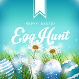 Beautiful Easter Blue Background with flowers and colored eggs in the grass Royalty Free Stock Photo