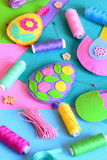 Beautiful Easter crafts set, colored thread spools, felt sheets, pins, buttons on a table Royalty Free Stock Images