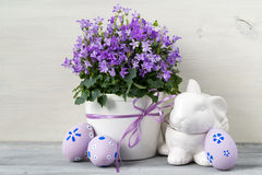Beautiful easter decoration with Campanula flowers, Easter eggs and ceramic rabbit Royalty Free Stock Image