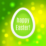 Beautiful Easter egg on green background with glow and bokeh par Royalty Free Stock Photo