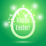 Beautiful Easter egg from a strip on a green background with glo Stock Images