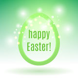 Beautiful Easter egg from a strip on a green background with glo Royalty Free Stock Images
