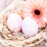 Beautiful Easter eggs in crocheted covers Stock Photo
