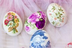 Beautiful Easter eggs decorated with paper napkins and flowers; decoupage technique stock photos