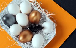 Beautiful easter eggs in paper nest. stock image