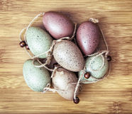 Beautiful Easter eggs on the wooden background, holiday symbol Royalty Free Stock Photography