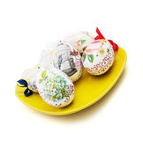 Beautiful Easter eggs on the yellow plate Royalty Free Stock Photos