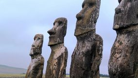 Beautiful Easter Island Moai looking to the sky 04. Rapa Nui Easter Island statues/ Moai with clouds on a sunny day with blue sky Stock Photo