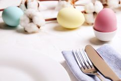 Easter laying table appointments, table setting options. Silverware, tableware items with festive decoration. Fork, knife and flow. Beautiful easter table royalty free stock photos