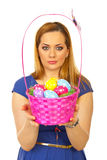 Beautiful easter woman with colorful basket Stock Photos