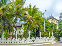 The beautiful edifice. The view on beautiful edifice of Department of Archaeology of Kandy surrounded with garden, behind the fence, Sri Lanka Royalty Free Stock Photos