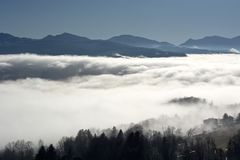 Beautiful effect of clouds and fog, which cover the valley
