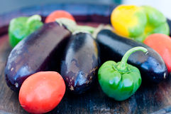 Beautiful eggplant and peppers ready to be cooked Royalty Free Stock Photos