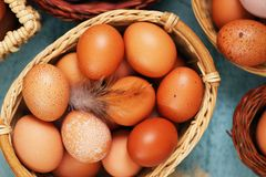 Beautiful eggs in baskets Royalty Free Stock Photos