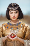 Beautiful Egyptian woman like Cleopatra outdoor Royalty Free Stock Image