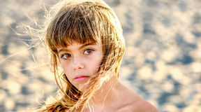 Beautiful eight year old girl  on the beach Royalty Free Stock Image