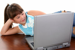 Beautiful Eight Year Old Girl With Laptop Computer Royalty Free Stock Photos