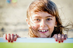 Beautiful eight year old girl smiling on the beach Royalty Free Stock Image