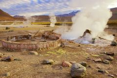 Beautiful El Tatio geysers at sunrise, Chile. Located at 4,320 meters above the sea level El Tatio geyser valley is one the highest elevated geyser field in Royalty Free Stock Photography