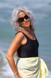 Beautiful elder lady at the beach Stock Photo