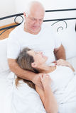 Beautiful elderly couple in bed. Royalty Free Stock Photos