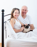 Beautiful elderly couple in bed. stock images