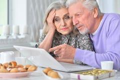 Beautiful elderly couple having breakfast Stock Images