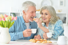 Beautiful elderly couple having breakfast Stock Photography