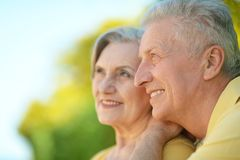 Beautiful elderly couple. Portrait of beautiful elderly couple outdoor in summer park Stock Images