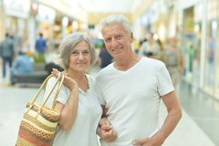 Beautiful elderly couple. Portrait of beautiful elderly couple in shopping mall Stock Photography