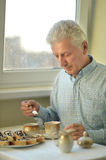 Beautiful elderly man. At home with cup of tea Royalty Free Stock Photo