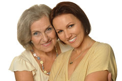 Beautiful elderly mother with an adult daughter stock image