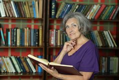Beautiful elderly woman with book Royalty Free Stock Photography