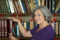 Beautiful elderly woman with book Royalty Free Stock Photo